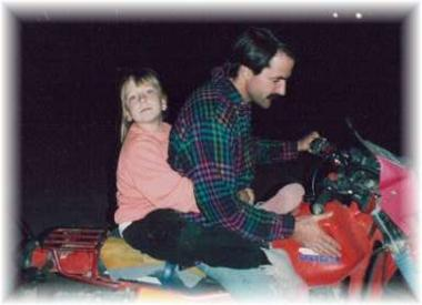 Giving my daughter a ride on a Saturday night during the drag races.